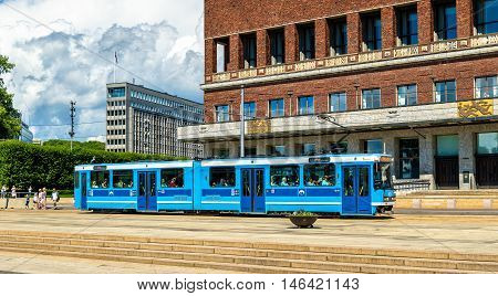 Oslo, Norway - July 7, 2016: City tram near the city hall of Oslo. The Oslo tram network consists of six lines with 99 stops