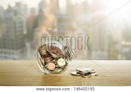 Money In The Glass Bottle On Wooden Table. Save Money Concept.