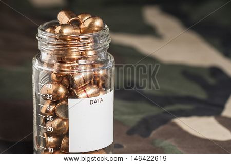 Cartridges On Camouflage Uniform Background