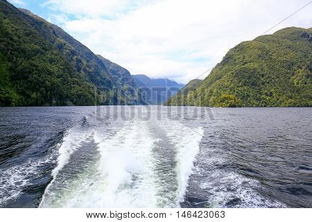 Back View Of A Boat, Beautiful Landscape. Milford Sound, New Zealand