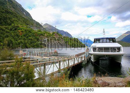 Journeys Boat Waiting For Her Passengers In Te Anau Lake, New Zealand