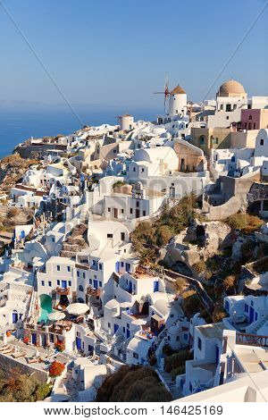 Day panorama of Oia Santorini with the famous windmill. Vertical shot.