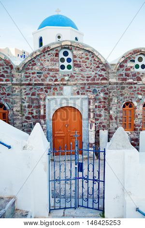 Church in Oia Santorini at dust. Vertical shot