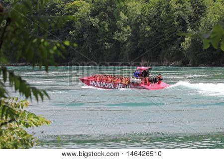 NIAGARA FALLS, CANADA - JULY 15, 2016. A popular tourist attraction the Whirlpool Jet Boat tour is a large jet boat tour that's sure to thrill and excite. The journey begins at the mouth of Lake Ontario and goes upstream till it reaches the gorge and rapi