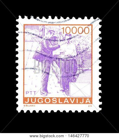 YUGOSLAVIA - CIRCA 1988 : Cancelled postage stamp printed by Yugoslavia, that shows Postman and resident.