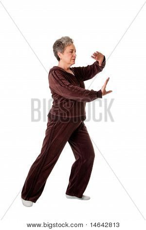 Senior Woman Tai Chi Yoga Übungen