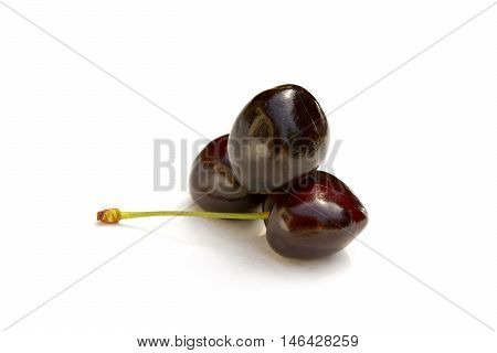 Sweet ripe cherries with leaf isolated on white background