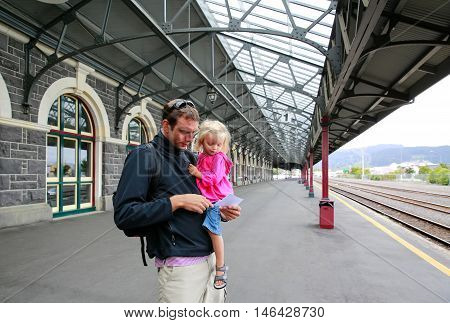 Father with his daughter at the Dunedin Railway Station New Zealand