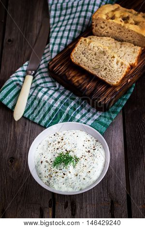 Multigrain Bread,dill  And Spiced Yoghurt On Rustic Background.