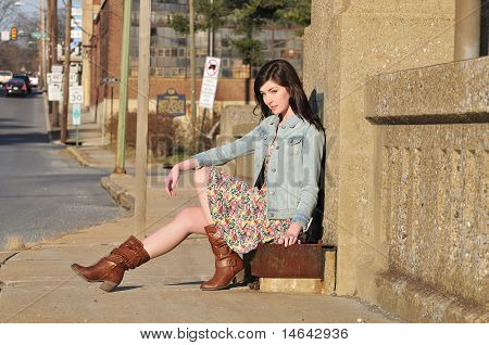 Girl Waiting For A Ride