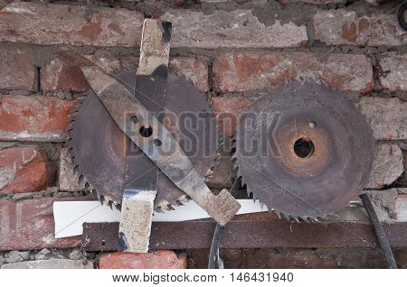 rusty circular saw in a shabby brick wall