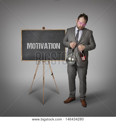 Motivation partyman text on blackboard with businessman and key