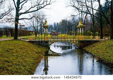 Chinese Bridge Over Small Stream. Autumn.russia,the Town Of Pushkin, Tsarskoe Selo. Alexander Park.