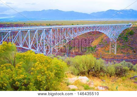 Rio Grande Gorge Bridge which is a steel bridge with arches built in 1965 and is 565 feet above the Rio Grande River taken near Taos, NM
