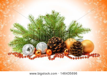 Christmas arrangement in a rustic style: cones tree balls beads on a fantastic celebratory background. Magic snow. Holiday dreams.