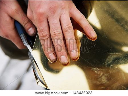 This photograph shows the hand cut metal