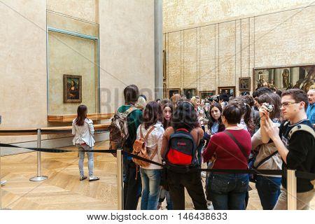 Paris, France - April 8, 2011: Students Walking Inside The Louvre Museum Near Mona Lisa Portrait