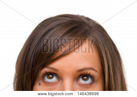 Young woman looking away isolated on white background close up