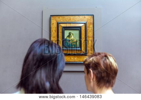 Paris, France - April 8, 2011: Two Women Looking At Johannes Vermeer Painting The Lacemaker