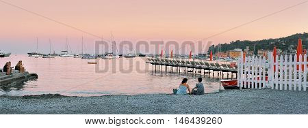 Santa Margherita, Liguria, Italy - August 27, 2016: evening sunset view from the beach at Port Santa Margherita