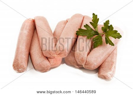 home made scottish sausages with parsley on white background