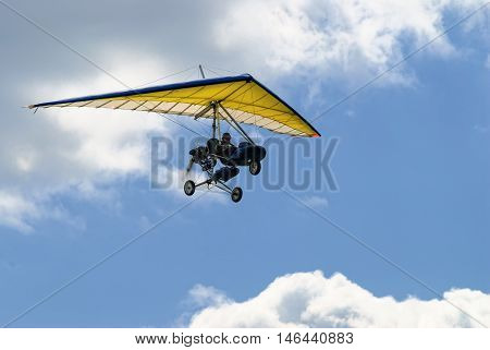 Yalutorovsk, Russia - May 24. 2008: The motorized hang glider in the sunset above sea