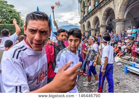 Antigua Guatemala - September 14 2015: Locals run in streets with lit torches during Guatemalan Independence Day celebrations
