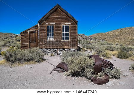 Pieces of an Old Car: pieces of an old car, in front of an old house, in the historic ghost town, Bodie