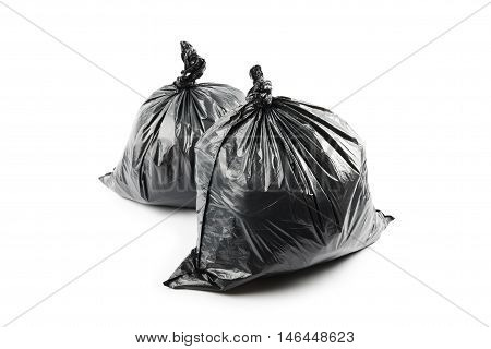 Two black garbage bags isolated on white background
