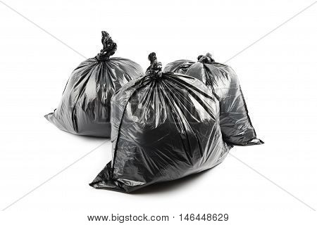 Three black garbage bags isolated on white background