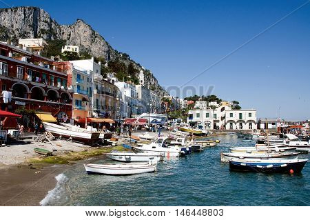 CAPRI, ITALY, MAY 11, 2012:  Harbor of the famous tourism place Capri island with a lot of visitors in Italy