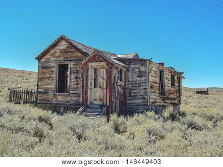 Dilapidated Prairie House: barely standing prairie house, with a red door, in historic ghost town, Bodie