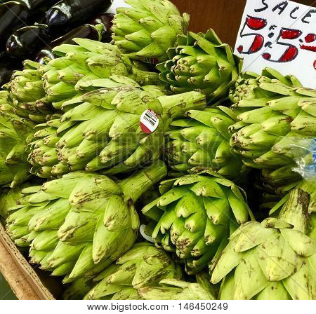 Beautiful green artichokes on sale at farmer's market.