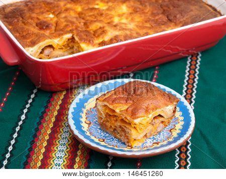 Italian lasagna with ham and cheese. Horizontal shot