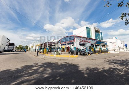 Workers Washing Cars At Outdoor Mexican Carwash