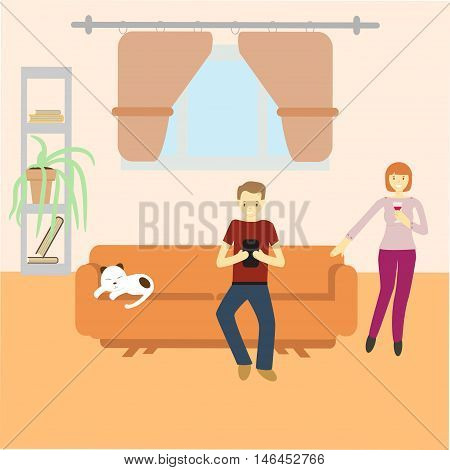 man sitting with gadget on couch and woman standing near the couch at their home with cat sleeping on couch