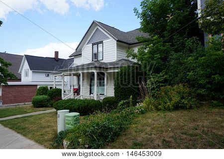 PETOSKEY, MICHIGAN / UNITED STATES - AUGUST 5, 2016: A white Victorian home on Mitchell Street near downtown Petoskey.