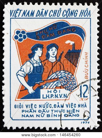 VIETNAM - CIRCA 1974: a stamp printed in Vietnam shows Armed Worker and Peasant circa 1974