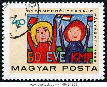 HUNGARY - CIRCA 1968: a stamp printed in Hungary shows Pioneers Saluting Communist Party Children's Painting 50th Anniversary of the Communist Party of Hungary circa 1968