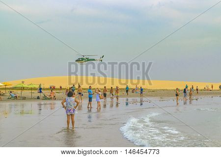 JERICOACOARA, BRAZIL, DECEMBER - 2015 - People at the main beach of Jericoacoara in Brazil