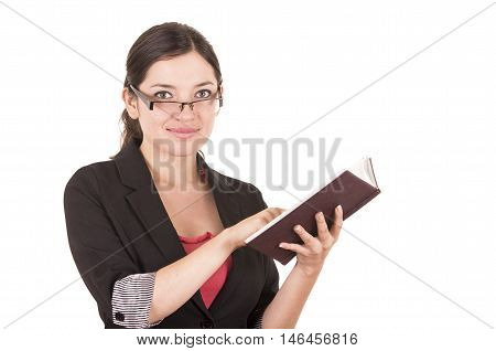portrait of pretty female teacher wearing glasses and holding book isolated on white