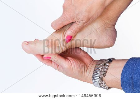 women hands holding the foot with painful bunions