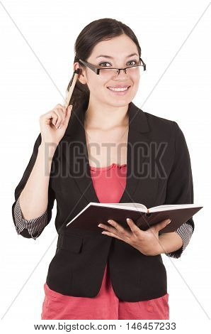 portrait of pretty female teacher wearing glasses and holding book gesturing listen isolated on white
