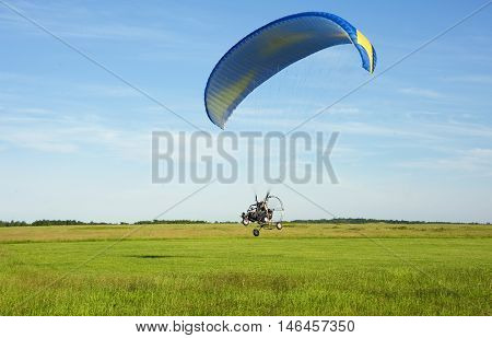 Powered paragliding take off from the field