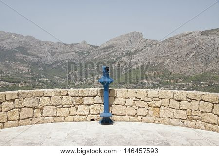 Blue panoramic telescope overlooking the valley of Guadalest in the province of Alicante Spain