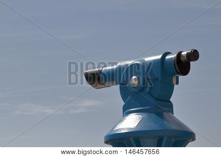 foreground of a blue panoramic telescope with the sky as background