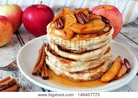 Autumn Pancake Stack With Baked Apples, Pecans And Cinnamon Topped With Maple Syrup, Table Scene