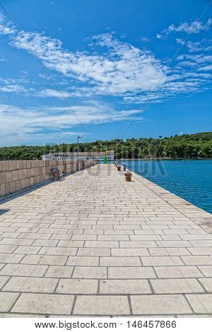 View of the the main pier in Luka on island Prvic in Sibenik archipelago, Croatia.