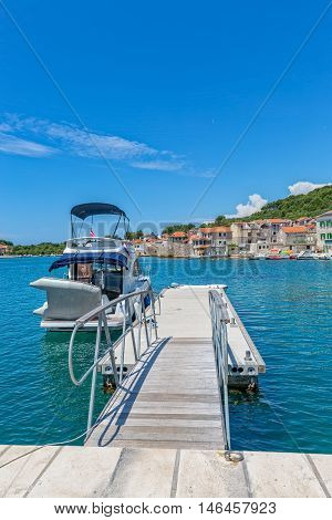Small boat anchored in the Prvic Luka port at beautiful summer day in Croatia.