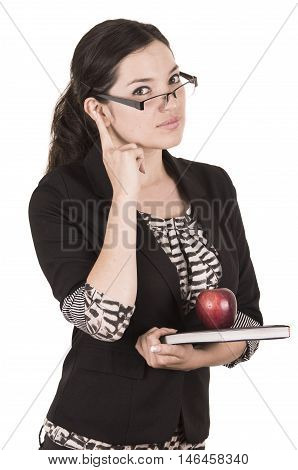 sweet female teacher holding red apple gesturing pay attention isolated on white